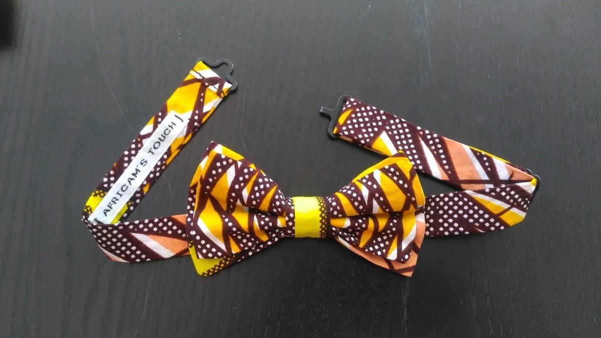 La Remise Aux Tissus Lyon bow knot slim in wax